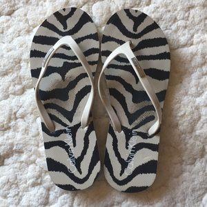 Calvin Klein zebra print flip flops
